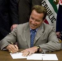 Governor Arnold Schwarzenegger signing